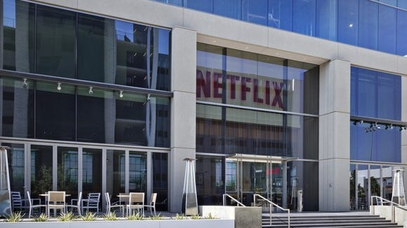 Netflix reels in customers after price hike, sending stock