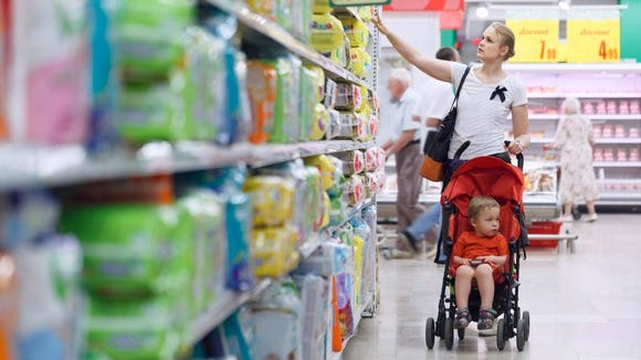 Woman shopping for diapers at a convenience store