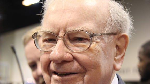 Warren Buffet smiling.