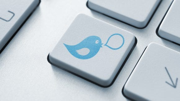 Computer button with Twitter logo on it.