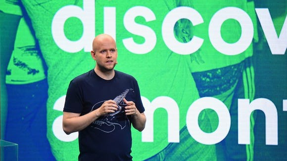 Spotify CEO Daniel Ek presenting on stage.