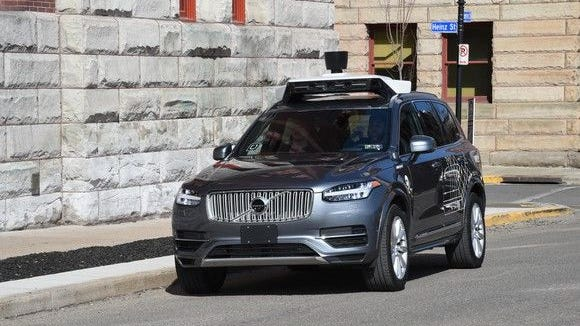 Car equipped with Uber's self driving technology.