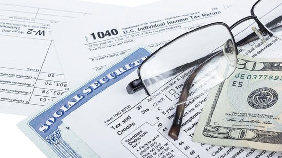 A Social Security card lying next to IRS form 1040.