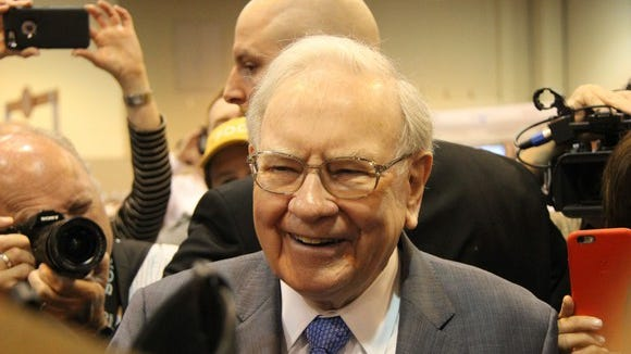 Warren Buffet speaking with the media.