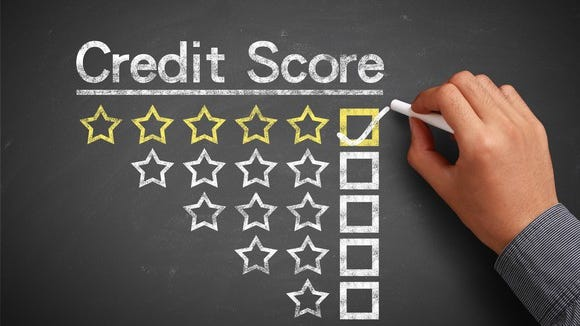 A credit score table denoted by one to five stars, with the five-star box being checked with chalk.