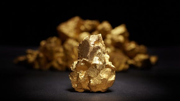 A piece of gold sitting on a table.