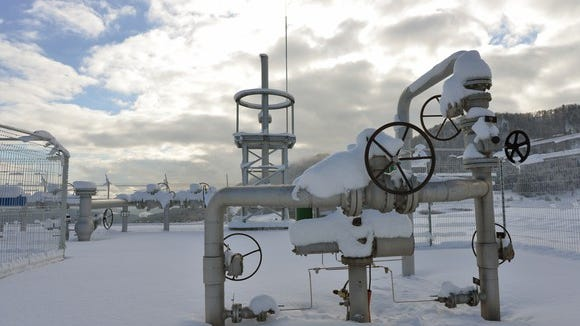 A snow covered natural gas well.