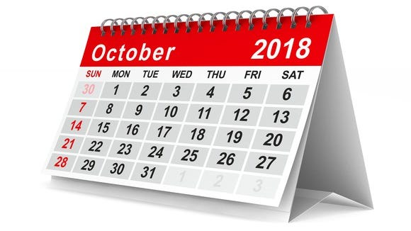 An October 2018 calendar standing on a surface.