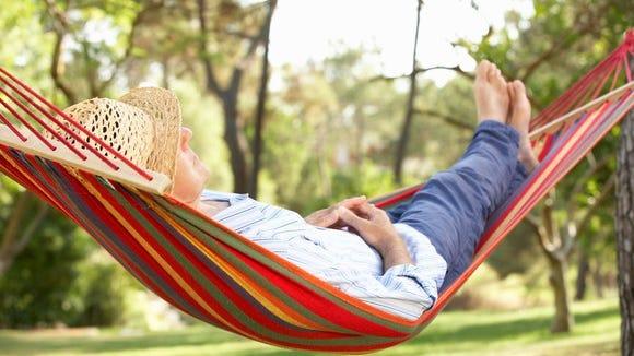 Someone relaxing in a hammock.