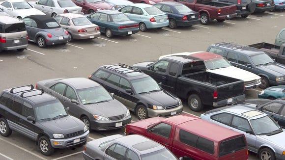 Parking lot full of cars.