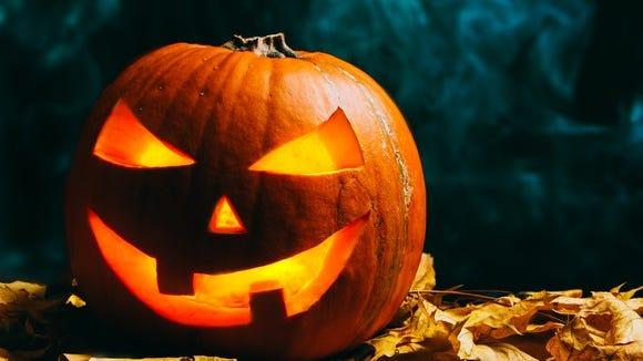 A carved pumpkin with a devious face.