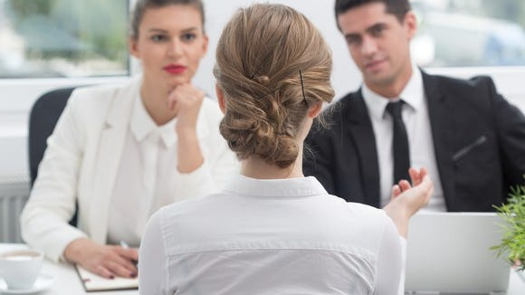 Two employers conducting a job interview with a woman