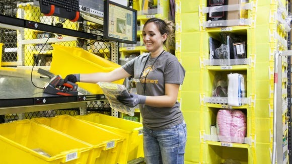 An Amazon worker in a fulfillment center