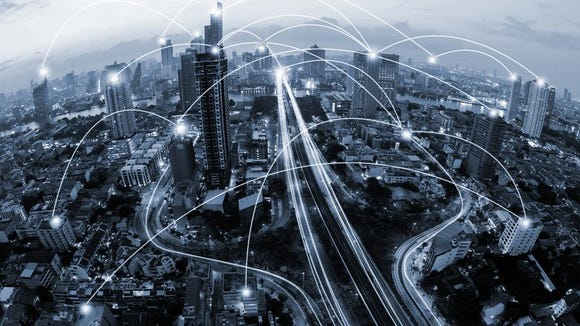 A monochromatic bird's-eye view of a city with multiple connected wireless points