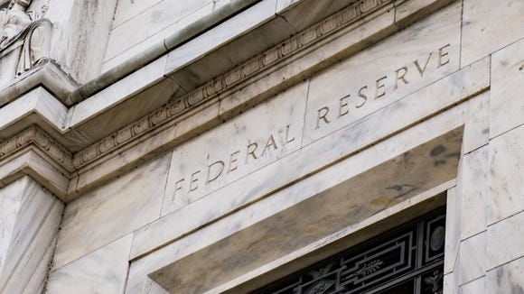 Rather than pause on interest rate hikes, the Fed needs to unwind the economic distortions from its massive monetary interventions.
