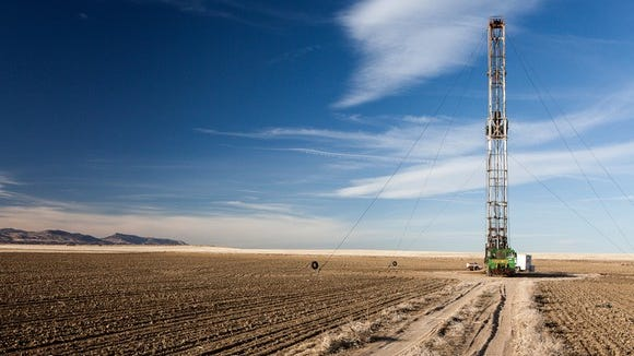 An oil rig in a field
