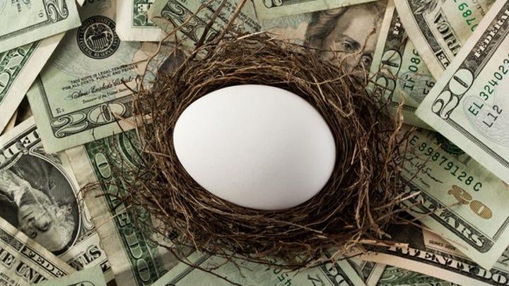 Nest egg sitting on money