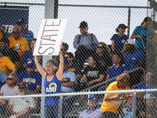 A fan holds up a sign to cheer on the Rambelles during the Division II South Central Super Regional against Texas A&M-Commerce Friday, May 18, 2018, at Mayer Field.