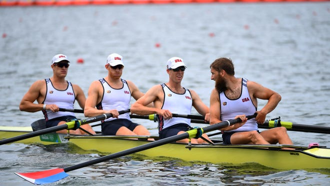 Henrik Rummel and Matthew Miller and Charles Cole and Seth Weil of the United States compete in the men's four heats at Lagoa Stadium during the Rio 2016 Summer Olympic Games.