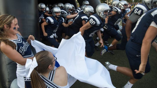 The Reitz football takes the field for their first