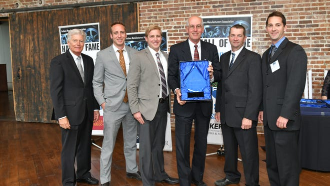Pictured are (from left) Brian Burton, president and CEO of the Indiana Manufacturers Association, John Smith, Neil Smith, Steve Smith, Jody Fledderman of the Indiana Manufacturers association board chair, and Chad Smith.