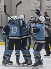 Stevenson players celebrate after scoring a goal against