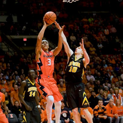 Mike Gesell bothers the shot of Illinois' Khalid Lewis