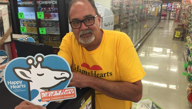 Skip Nugent and the whole Best Buy Market team gears up for the annual Happy Hearts Day fundraiser in memory of his daughter Heather Nugent. Money raised will go to Children's Hospital in Madera. Photo taken on May 12, 2016.