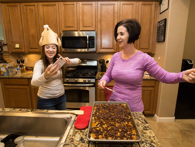 Big Sister Melissa Wilbur prepares saltine cracker