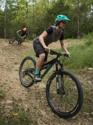 On Your Left Cycle's Derek Fetko, left, and Parklands' program coordinator, Ali Greenwell, come around a berm at the new Parklands Silo Bike Center in Turkey Run Park. Sept. 11, 2017
