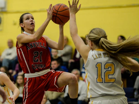 Annville-Cleona's Meredith Bachman drives to the hoop against Northern Lebanon's Amber Kintzer.