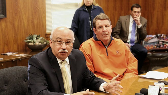UTEP administrator Richard Adauto, left, and men's basketball coach Tim Floyd announce at a news conference in January 2014 that three players had been kicked off of the team over sports gambling.