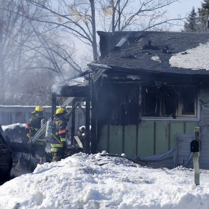 Firefighters battle a fire at 206 Welhouse Drive in