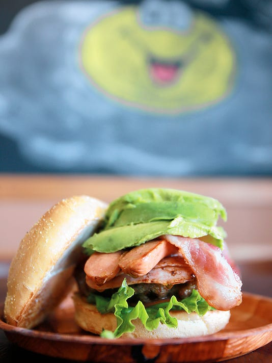 The Mucha Carne burger features three kinds of meat and is topped with avocado slices. The meaty combination is one of the top picks at Panda Burgers.