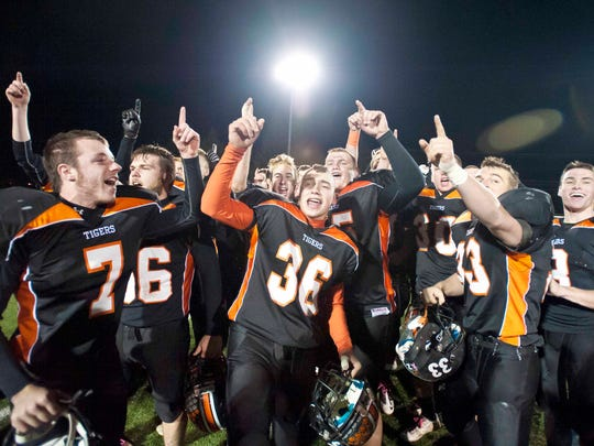 Middlebury celebrates their victory over St. Johnsbury