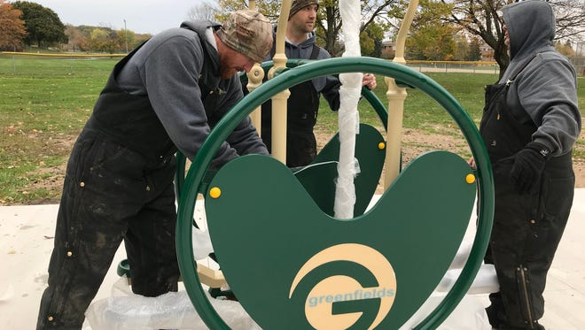 Delta Township staff installed five pieces of outdoor exercise equipment, including this elliptical stationary bike, Wednesday, Nov. 1 on a 1,200-square-foot concrete slab at Sharp Park. The first phase of the new outdoor gym cost $25,000 and was partially funded with a $15,000 grant.
