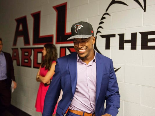 Atlanta Falcons first-round draft pick Keanu Neal walks into a news conference at the football team's practice facility Friday, April 29, 2016, in Flowery Branch, Ga. (AP Photo/David Goldman)