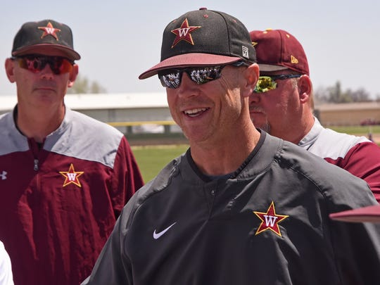 Windsor High School head baseball coach Brad Deal is all smiles as he talks to his team following their 4-1 win against Holy Family on Saturday.  Windsor is ranked number one in the 4A polls.