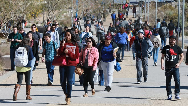 UTEP students return to campus during the first day of classes for the spring 2016 semester.