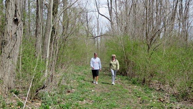 In 2015, Joe Hellrung, left, board president of the Society for the Preservation and Use of Resources, hiked what will become the Wayne County National Road Heritage Trail with board member Karen Montgomery.