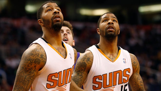 Suns forwards Markieff (left) and Marcus Morris box out for a rebound during the fourth quarter against the Lakers at US Airways Center January 15, 2014.