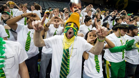 Nov 16, 2015; Eugene, OR, USA; Oregon Ducks fans show off their game attire before the start of a game against Baylor at Matthew Knight Arena. Mandatory Credit: Troy Wayrynen-USA TODAY Sports