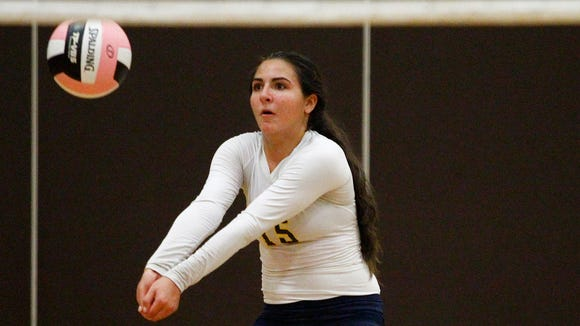 Panas libero Sabrina Patriciello sets a pass in the Vikings Brown and Gold volleyball tournament at Clarkstown South High School in West Nyack on Saturday, Sept. 20, 2014.