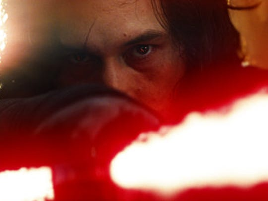 "This image released by Lucasfilm shows Adam Driver as Kylo Ren in a scene from the upcoming ""Star Wars: The Last Jedi,"" expected in theaters in December."
