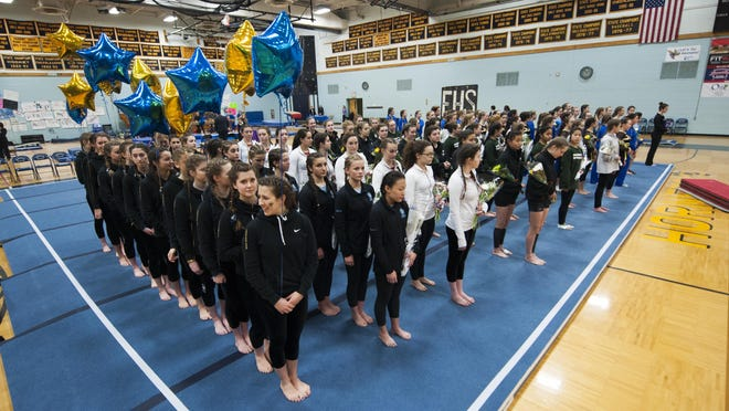 The teams line up for introductions during the Vermont state high school gymnastics championship at Essex high school on Saturday afternoon in Essex.