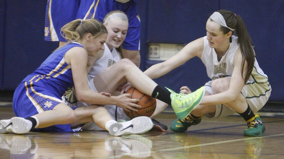 Rush Henrietta's Sarah Sweazy, center, and teammate Emily Nestler, right, battle for possession of a loose ball during the Section V Class AA Tournament last year.