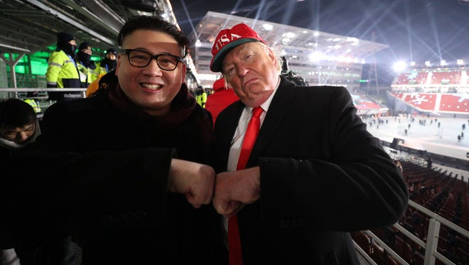 A Kim Jon Un impersonator and a Donald Trump impersonator enjoy each other's company after the opening ceremony of the Pyeongchang 2018 Olympic Winter Games at Pyeongchang Olympic Stadium.