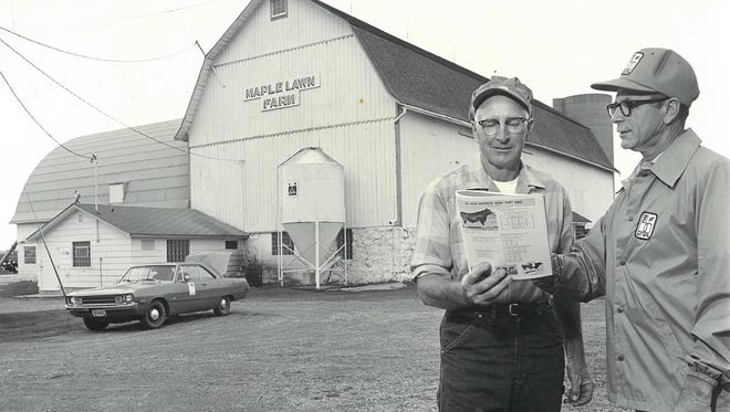 Retired East Central AI technician Mel Sorensen, right, visits with former East Central Breeders board president, John Bradley, of Maple Lawn Farm near Pickett, in the early 1970s.