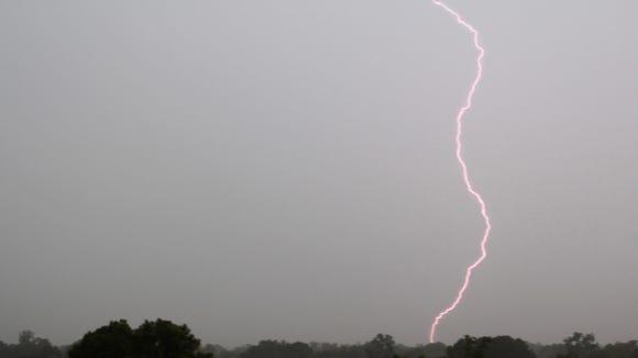 A bolt of lightning strikes down in Monroe during a thunderstorm.