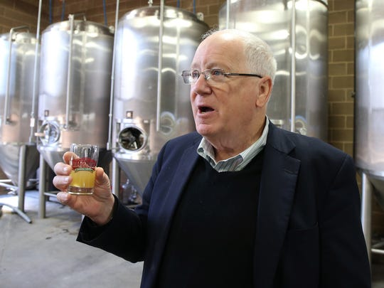 World Food Prize President Ken Quinn samples the Iowa Borlauger, a wheat beer named in honor of Cresco native Norman Borlaug, last year. The beer was available on tap at Madhouse Brewery in Des Moines to coincide with World Food Prize events in October.